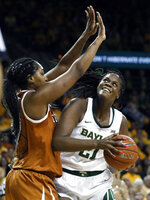 FILE - In this Feb. 25, 2019, file photo, Texas forward Jatarie White (40) defends as Baylor's Kalani Brown (21) works for a shot opportunity in the second half of an NCAA college basketball game in Waco, Texas. Baylor's senior center has been dominant on both ends of the court. She's averaging 15.5 points, 7.9 rebounds and 1.5 blocks. (AP Photo/Tony Gutierrez, File)
