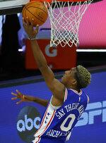 Philadelphia 76ers' Josh Richardson (0) attacks the basket against the Orlando Magic during the second half of an NBA basketball game Friday, Aug. 7, 2020, in Lake Buena Vista, Fla. (Kevin C. Cox/Pool Photo via AP)