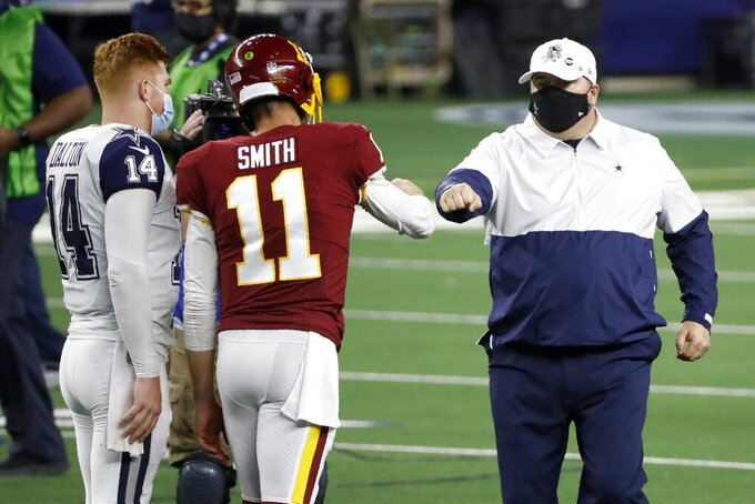 Dallas Cowboys' Andy Dalton (14) and head coach Mike McCarthy, right, greet Washington Football Team quarterback Alex Smith (11) after their NFL football game in Arlington, Texas, Thursday, Nov. 26, 2020. (AP Photo/Roger Steinman)