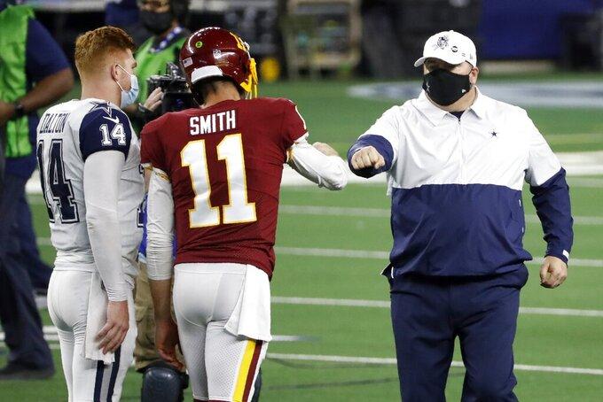 Dallas Cowboys' Andy Dalton (14) and head coach Mike McCarthy, right, greet Washington Football Team quarterback Alex Smith (11) after their NFL football game in Arlington, Texas, Thursday, Nov. 26, 2020. (AP Photo/Roger Steinman)