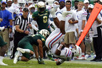 Florida quarterback Anthony Richardson (15) gets upended by South Florida safety Brock Nichols during the second half of an NCAA college football game Saturday, Sept. 11, 2021, in Tampa, Fla. (AP Photo/Chris O'Meara)