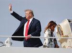President Donald Trump and first lady Melania Trump board Air Force One, Thursday, April 18, 2019, at Andrews Air Force Base, Md. President Trump is traveling to his Mar-a-lago estate to spend the Easter weekend in Palm Beach, Fla. (AP Photo/Pablo Martinez Monsivais)