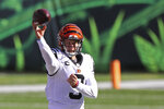 Cincinnati Bengals quarterback Joe Burrow (9) throws during the first half of an NFL football game against the Tennessee Titans, Sunday, Nov. 1, 2020, in Cincinnati. (AP Photo/Jay LaPrete)