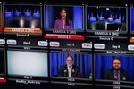 A portion of a video monitor is shown in a TVW control room, Thursday, Oct. 22, 2020, during a debate in Olympia, Wash., between U.S. Rep. Denny Heck, D-Wash., lower center, and Washington Sen. Marko Liias, D-Lynnwood, lower right, in the race for lieutenant governor of Washington state. (AP Photo/Ted S. Warren)