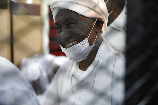 Former Sudanese vice president Ali Ossman Taha is behind bars during the trial of ousted Sudanese president Omar al-Bashir and over two dozen top officials in his government, in Khartoum, Sudan, Tuesday, July 21, 2020. The 76-year-old al-Bashir has been jailed in Khartoum since his ouster, facing several separate trials related to his rule and the uprising that helped oust him. Al-Bashir is also wanted by the International Criminal Court on charges of war crimes and genocide linked to the Darfur conflict in the 2000s. (AP Photo/Marwan Ali)