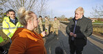 Britain's Prime Minister Boris Johnson, talks to a woman, during a visit to see the effects of recent flooding, in Stainforth, England, Wednesday, Nov. 13, 2019. (Danny Lawson/Pool Photo via AP)