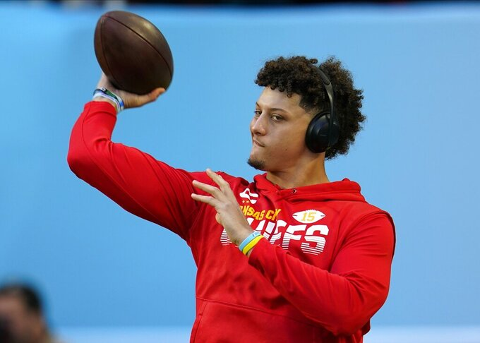 Kansas City Chiefs quarterback Patrick Mahomes warms up before the NFL Super Bowl 54 football game against the San Francisco 49ers Sunday, Feb. 2, 2020, in Miami. (AP Photo/David J. Phillip)