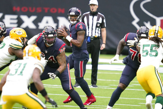 Houston Texans quarterback Deshaun Watson (4) drops back to pass during the first half of an NFL football game against the Green Bay Packers Sunday, Oct. 25, 2020, in Houston. (AP Photo/Sam Craft)