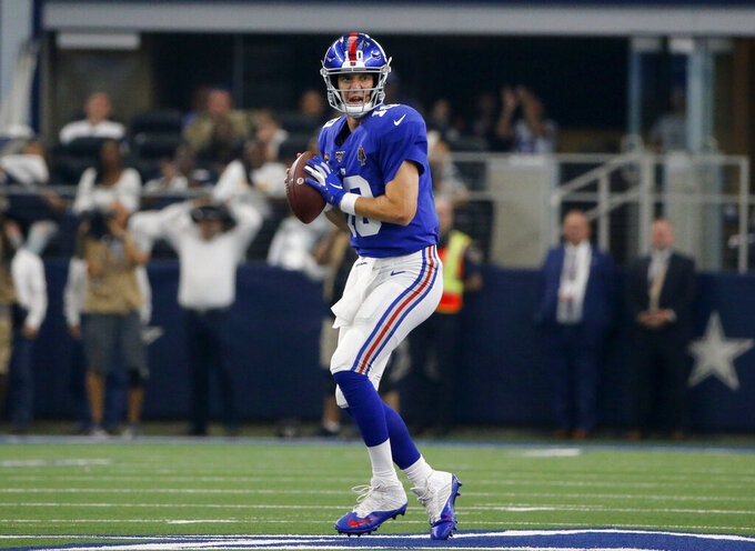 New York Giants quarterback Eli Manning (10) drops back to throw in the second half of a NFL football game against the Dallas Cowboys in Arlington, Texas, Sunday, Sept. 8, 2019. (AP Photo/Michael Ainsworth)