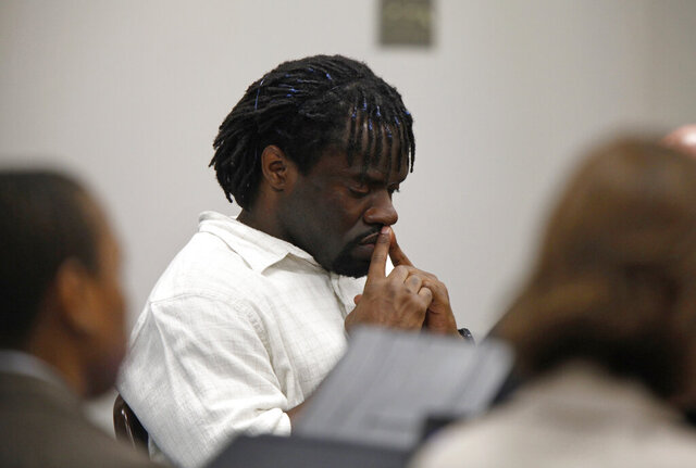 FILE - In this April 20, 2012 file photo,  Marcus Robinson, an inmate on N.C.'s death row, listens as Cumberland County Senior Resident Superior Court Judge Greg Weeks found that racial bias played a role in Robinson's trial and sentencing and he should be removed from death row and serve a life sentence.  North Carolina's Supreme Court will let Robinson, a death row inmate serve out a lifetime prison sentence he was previously granted. The narrow 4-3 ruling, Friday, Aug. 14, 2020, may also allow three other inmates facing the death penalty to get similar relief under the now-defunct Racial Justice Act. (Shawn Rocco/The News & Observer via AP)