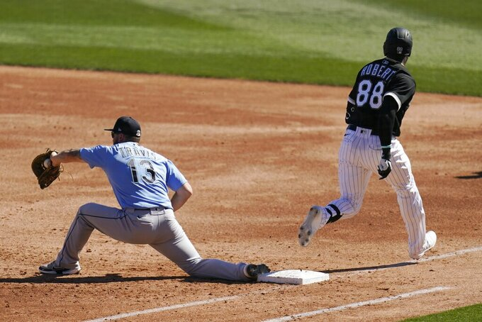 Chicago White Sox's Luis Robert (88) beats out an infield single as Seattle Mariners first baseman Sam Travis (13) makes a late catch during the third inning of a spring training baseball game Friday, March 5, 2021, in Phoenix. (AP Photo/Ross D. Franklin)