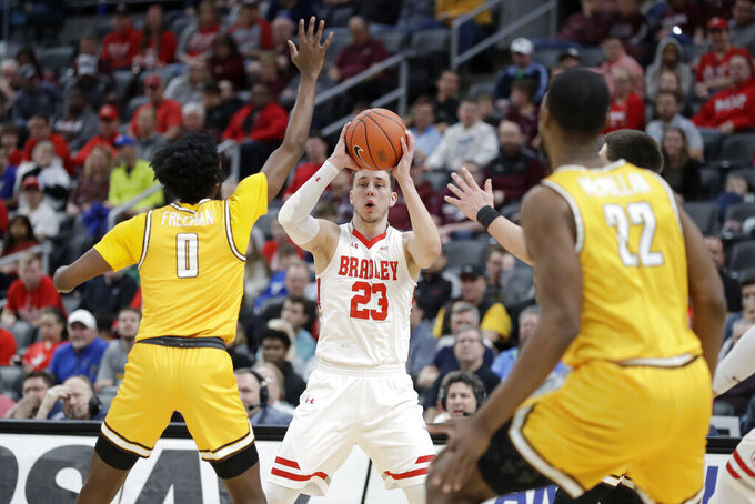Bradley's Ville Tahvanainen (23) looks to pass as Valparaiso's Javon Freeman-Liberty (0) and Mileek McMillan (22) defend during the first half of an NCAA college basketball game in the championship of the Missouri Valley Conference men's tournament Sunday, March 8, 2020, in St. Louis. (AP Photo/Jeff Roberson)