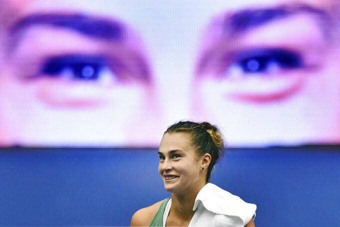 Aryna Sabalenka of Belarus reacts after winning a match against Sara Sorribes Tormo of Spain during the Ostrava Open 2020 tennis tournament in Ostrava, Czech Republic, Friday, Oct. 23, 2020. (Jaroslav Ozana/CTK via AP)