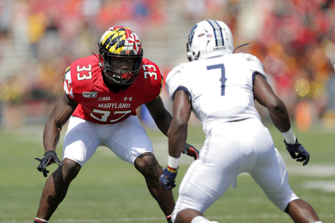 Maryland's Deonte Banks (33) defends against Howard's Ray Williams during a punt in the first half of an NCAA college football game, Saturday, Aug. 31, 2019, in College Park, Md. (AP Photo/Julio Cortez)