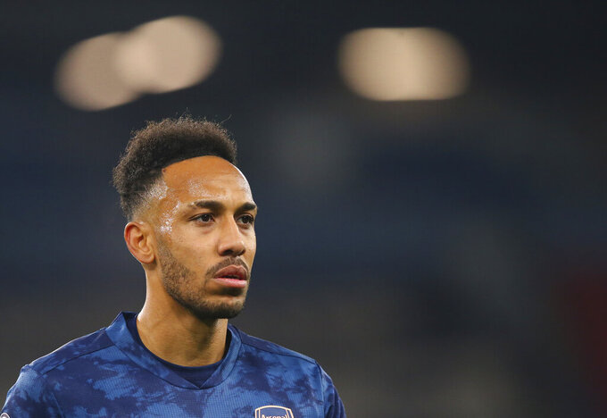 Arsenal's Pierre-Emerick Aubameyang reacts during the English Premier League soccer match between Manchester City and Arsenal at the Etihad stadium in Manchester, England, Saturday, Oct. 17, 2020. (Alex Livesey/Pool via AP)