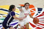 Maryland's Katie Benzan (11) is defended by Northwestern's Veronica Burton (12) during the first half of an NCAA college basketball semifinal game at the Big Ten Conference tournament, Friday, March 12, 2021, in Indianapolis. (AP Photo/Darron Cummings)