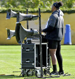 Pittsburgh Steelers offensive tackle Zach Banner plays music for the team as they warm up during NFL football practice Friday, Sept. 17, 2021, in Pittsburgh. (Matt Freed/Pittsburgh Post-Gazette via AP)
