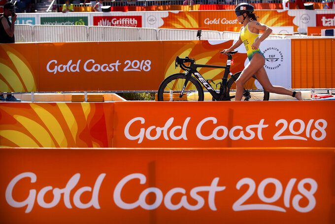 FILE - In this April 7, 2018 file photo, Ashleigh Gentle of Australia competes during the mixed team relay triathlon at the Southport Broadwater Parklands during the 2018 Commonwealth Games on the Gold Coast, Australia. Gentle, is looking forward to possibly representing her country again when the mixed team format makes its Olympic debut in Tokyo. That'll be in addition to her place in the women's individual race. (AP Photo/Mark Schiefelbein,  File)