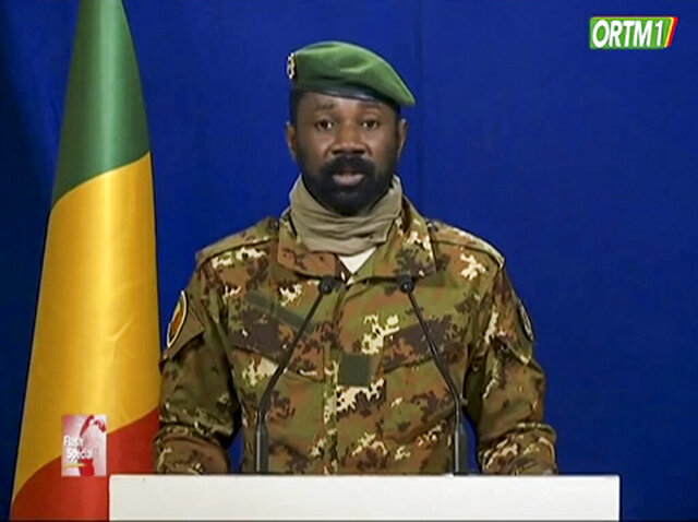 Seen on national broadcaster ORTM TV, Col. Assimi Goita, one of the soldiers identifying themselves as the National Committee for the Salvation of the People, sits with others during a televised broadcast on Monday, Sept. 21, 2020 in Bamako, Mali. The head of Mali's military junta Col. Assimi Goita said Monday, Sept. 21, 2020 that he will serve as the vice president in a transitional government that is supposed to bring about a return to democracy more than a month after a coup d'etat, with Maj. Col. Bah N'Daw named as president of the transitional government. (ORTM TV via AP)