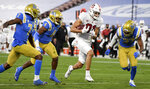 Stanford wide receiver Brycen Tremayne (81) catches a pass and runs for a first down against UCLA during the first half of an NCAA college football game Saturday, Dec. 19, 2020, in Pasadena, Calif.  (Keith Birmingham/The Orange County Register via AP)