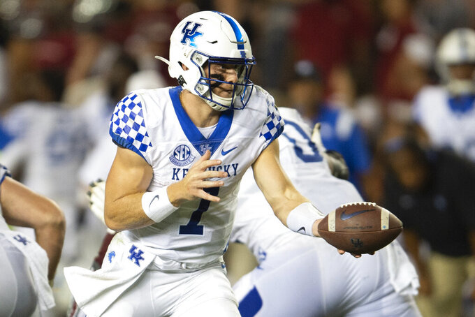 Kentucky quarterback Will Levis (7) holds the ball in the second half of an NCAA college football game against South Carolina, Saturday, Sept. 25, 2021, at Williams-Brice Stadium in Columbia, S.C. (AP Photo/Hakim Wright Sr.)