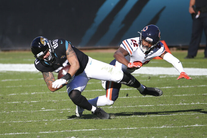 Jacksonville Jaguars tight end James O'Shaughnessy (80) makes a reception in front of Chicago Bears cornerback Kindle Vildor during the second half of an NFL football game, Sunday, Dec. 27, 2020, in Jacksonville, Fla. (AP Photo/Stephen B. Morton)