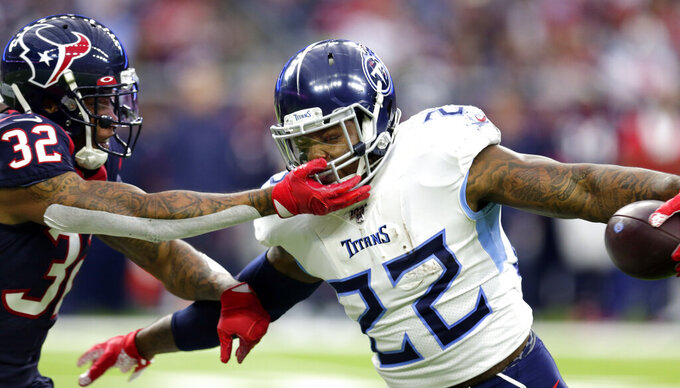 Houston Texans cornerback Lonnie Johnson (32) reaches to tackle Tennessee Titans running back Derrick Henry (22) during the first half of an NFL football game Sunday, Dec. 29, 2019, in Houston. (AP Photo/Michael Wyke)