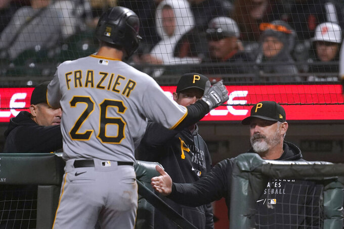 Pittsburgh Pirates' Adam Frazier (26) is congratulated by manager Derek Shelton, right, after scoring against the San Francisco Giants during the eighth inning of a baseball game in San Francisco, Saturday, July 24, 2021. (AP Photo/Jeff Chiu)
