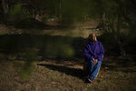 Hazel Harding Currence, 78, a Herring Pond Wampanoag Tribe Elder, sits for a portrait in her backyard in Bourne, Mass., Tuesday, Oct. 6, 2020.
