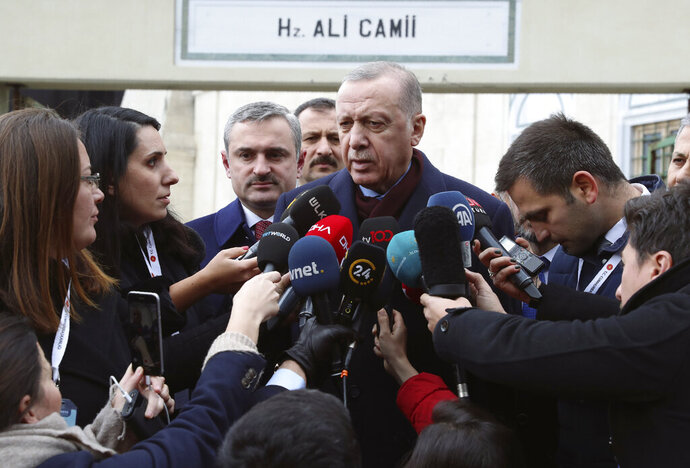 Turkey's President Recep Tayyip Erdogan speaks to the media after Friday prayers, in Istanbul, Friday, Jan. 17, 2020.  Erdogan expressed doubt that Khalifa Hifter, the head of the self-styled Libyan National Army, would abide by the cease-fire.