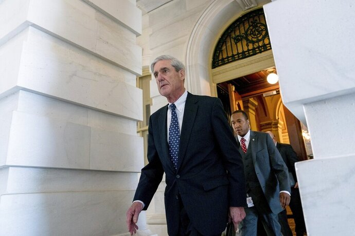 FILE - In this June 21, 2017, file photo, Special Counsel Robert Mueller departs Capitol Hill following a closed-door meeting in Washington. The debate over special counsel Robert Mueller's report is getting new life with word that Mueller has agreed to testify publicly before two House committees. Democrats say Mueller will appear July 17 in back-to-back sessions of the Judiciary and Intelligence committees. (AP Photo/Andrew Harnik, File)