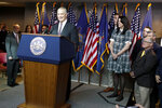 Pennsylvania Speaker of the House, Mike Turzai, left, stands the podium beside his wife Lydia, center right, and one of his sons, Matt, center, as he announces at a news conference he will not run for another term as a Pennsylvania Representative, Thursday, Jan. 23, 2020, in McCandless, Pa. (AP Photo/Keith Srakocic)