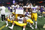 LSU players celebrate after the Southeastern Conference championship NCAA college football game against Georgia, Saturday, Dec. 7, 2019, in Atlanta. LSU won 37-10. (AP Photo/John Bazemore)