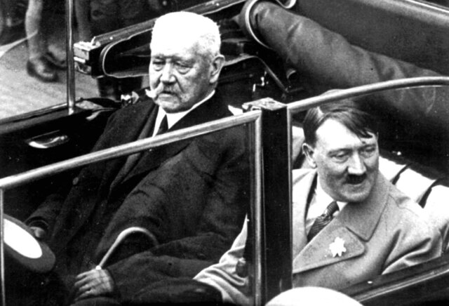 FILE - In this May 1, 1933 file photo German President Paul von Hindenburg, left, and Adolf Hitler, right, sit in a car during a labor day celebration in Berlin. The Berlin state government on Thursday struck the Prussian aristocrat Paul von Hindenburg off of its honorary citizen list, citing his act as president in 1933 of appointing Hitler as chancellor, the dpa news agency reported. Hindenburg was elected president in 1925 and served in that role until his death in 1934. (AP Photo)