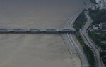 A part of a main road near the Han River is flooded due to heavy rain in Seoul, South Korea, Thursday, Aug. 6, 2020. The state-run Han River Flood Control Office issued a flood alert near a key river bridge in Seoul, the first such advisory since 2011. (AP Photo/Lee Jin-man)