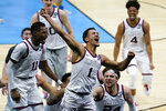 FILE - In this April 3, 2021, file photo, Gonzaga guard Jalen Suggs (1) celebrates making the game-winning basket against UCLA during overtime in a men's Final Four NCAA college basketball tournament semifinal in Indianapolis. Suggs was selected by the Orlando Magic in the NBA draft Thursday, July 20, 2021. (AP Photo/Michael Conroy, File)