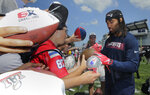 New England Patriots cornerback Stephon Gilmore signs autographs for fans after an NFL football training camp practice in Foxborough, Mass., Friday, July 26, 2019. (AP Photo/Charles Krupa)