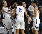 FILE - In this Feb. 26, 2018, file photo, Connecticut head coach Geno Auriemma, center, and player Katie Lou Samuelson, left, smile as seniors Gabby Williams, center, and Kia Nurse leave play for the final time in regular season play during the second half an NCAA college basketball game against South Florida, in Storrs, Conn. UConn finishes No. 1 in The Associated Press women's basketball poll for the fifth straight year. The Huskies (32-0) enter the NCAA Tournament as the lone unbeaten team and went wire-to-wire as the unanimous top team. They received all 32 votes from the national media panel Monday, March 12, 2018. (AP Photo/Jessica Hill, File)