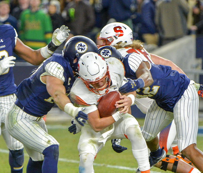 Syracuse quarterback Tommy DeVito (13) is sacked by the Notre Dame defense during an NCAA college football game, Saturday, Nov. 17, 2018, at Yankee Stadium in New York. (AP Photo/Howard Simmons)