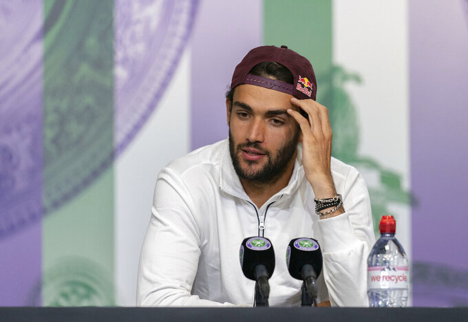 Italy's Matteo Berrettini attends a press conference after being defeated by Serbia's Novak Djokovic in the men's final against at the Wimbledon Tennis Championships in London, Sunday, July 11, 2021. (Joe Toth/Pool via AP)