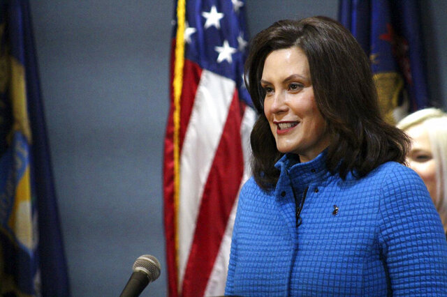 In this Monday, May 18, 2020 photo provided by the Michigan Office of the Governor, Michigan Gov. Gretchen Whitmer seeks during a news conference in Lansing, Mich. Restaurants, bars and other retail businesses can reopen in much of northern Michigan starting Friday, May 22, Gov. Whitmer announced Monday — a key step for the tourism-dependent region before the Memorial Day weekend and summer season. (Michigan Office of the Governor via AP, Pool)
