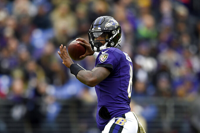 Baltimore Ravens quarterback Lamar Jackson throws a pass against the Houston Texans during the first half of an NFL football game, Sunday, Nov. 17, 2019, in Baltimore. (AP Photo/Gail Burton)