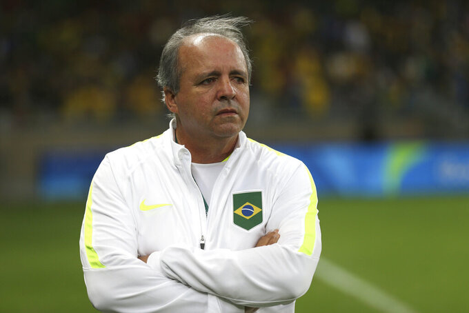 FILE - In this Aug. 12, 2016 file photo, Brazil's coach Oswaldo Alvarez Vadao, looks on prior to a quarter-final match at the women's Olympic football tournament between Brazil and Australia at the Mineirao Stadium in Belo Horizonte, Brazil. Oswaldo Alvarez, who coached Brazil's women's soccer team in the latest two World Cups, died Monday, May 25, 2020 in a hospital in Sao Paulo, according to the Brazilian soccer confederation. Alvarez Vadao recently said he was getting treatment for a liver cancer. (AP Photo/Eugenio Savio, File)