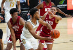 Colorado guard D'Shawn Schwartz, front, passes the ball as Washington State center Dishon Jackson, left, and forward DJ Rodman defend during the second half of an NCAA college basketball game Wednesday, Jan. 27, 2021, in Boulder, Colo. (AP Photo/David Zalubowski)