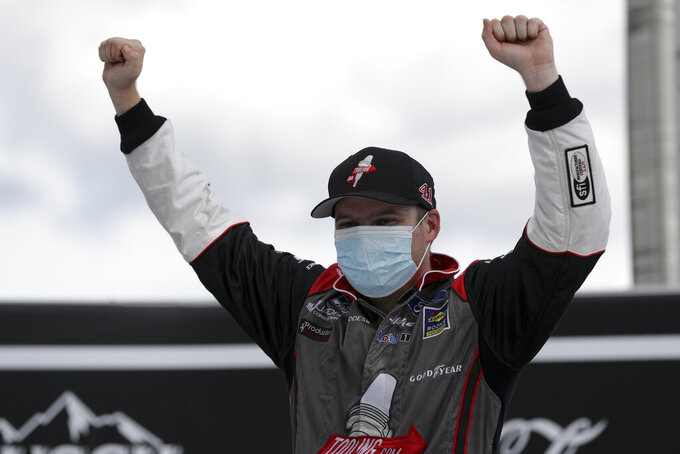 Cole Custer celebrates after winning a NASCAR Cup Series auto race Sunday, July 12, 2020, in Sparta, Ky. (AP Photo/Mark Humphrey)