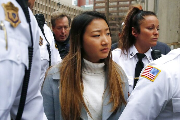 Inyoung You leaves Suffolk Superior Court in Boston, Friday, Nov. 22, 2019 after pleading not guilty to involuntary manslaughter. Prosecutors say You sent Alexander Urtula more than 47,000 text messages in the last two months of their relationship, including many urging him to