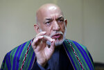 Former Afghan President Hamid Karzai speaks during an interview to the Associated Press in Kabul, Afghanistan, Sunday, June 20, 2021. Karzai said the United States came to Afghanistan to fight extremism and bring stability to his war-tortured nation and is leaving nearly 20 years later having failed at both. (AP Photo/Rahmat Gul)