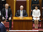 Former soldier David Hurley, center, is sworn in as Australia's governor-general at a ceremony in Parliament House in Canberra Monday, July 1, 2019. Hurley will officiate on Tuesday when Parliament resumes for the first time since Prime Minister Scott Morrison's conservative government was elected to a third three-year term. (AP Photo/Rod McGuirk)