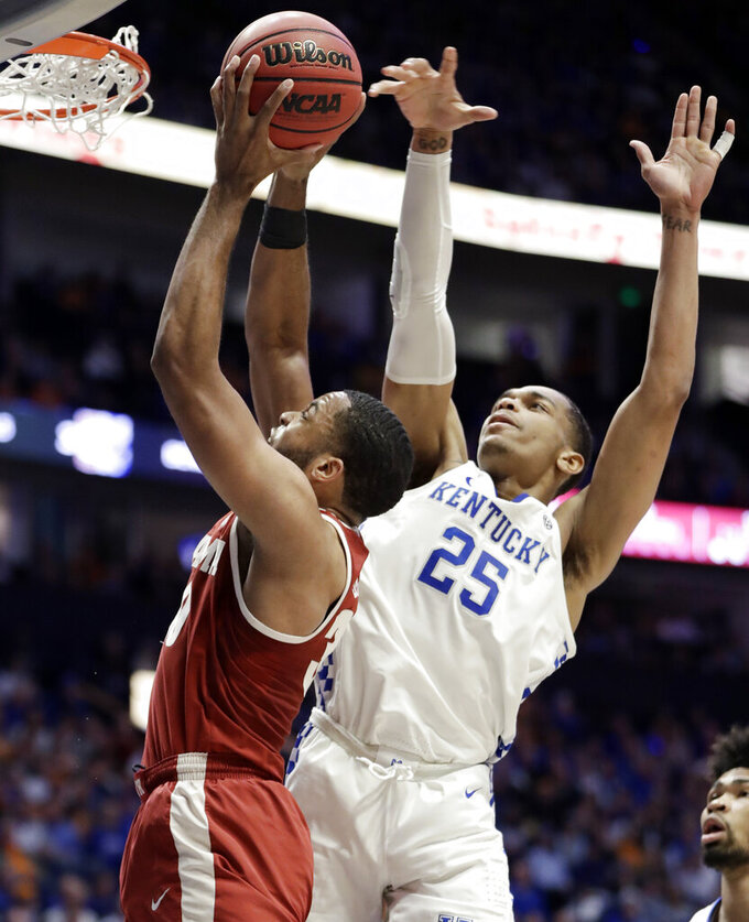 Alabama forward Galin Smith (30) shoots as he is defended by Kentucky forward PJ Washington (25) in the first half of an NCAA college basketball game at the Southeastern Conference tournament Friday, March 15, 2019, in Nashville, Tenn. (AP Photo/Mark Humphrey)