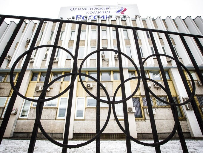 FILE - In this Dec. 6, 2017, file photo, the building of the Russian Olympic Committee is seen through a gate decorated with the Olympic rings, in Moscow, Russia. The ruling on whether Russia can keep its name and flag for the Olympics will be announced on Thursday Dec. 17, 2020. The Court of Arbitration for Sport said Wednesday that three of its arbitrators held a four-day hearing last month in the dispute between the World Anti-Doping Agency and its Russian affiliate, known as RUSADA. (AP Photo/Alexander Zemlianichenko, File)